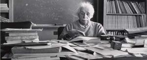 Einstein working at a messy desk